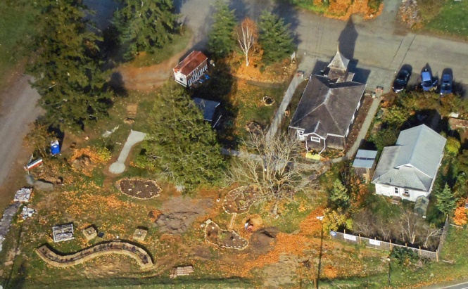 In this aerial view, you can see Q Gardens starting to take shape. The garden, located just off Highway 101 in Quilcene, will feature demonstration areas to teach Jefferson County residents about sustainable gardening practices